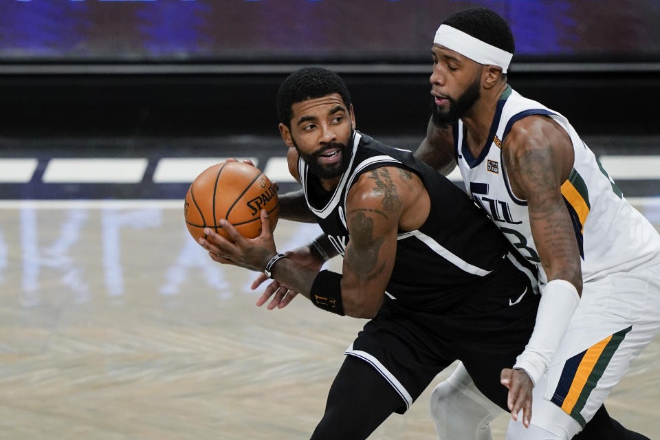 Utah Jazz's Royce O'Neale, right, defends Brooklyn Nets' Kyrie Irving (11) during the first half of an NBA basketball game Tuesday, Jan. 5, 2021, in New York. (AP Photo/Frank Franklin II)