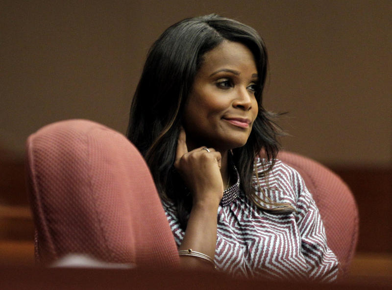 """Tameka Foster Raymond, ex-wife of Hip-hop artist Usher Raymond, reacts during testimony by Usher Raymond in court for a custody fight involving their two sons Tuesday, May 22, 2012, in Atlanta. Usher Raymond testified in court on Tuesday that Tameka Foster Raymond spit at and tried to fight his girlfriend during one nasty visit. He said his ex-wife hit him during the dispute, but that he didn't press charges because """"I didn't want the boys to know that their father put their mother in jail."""" The two were married in 2007 and divorced two years later. (AP Photo/David Goldman)"""
