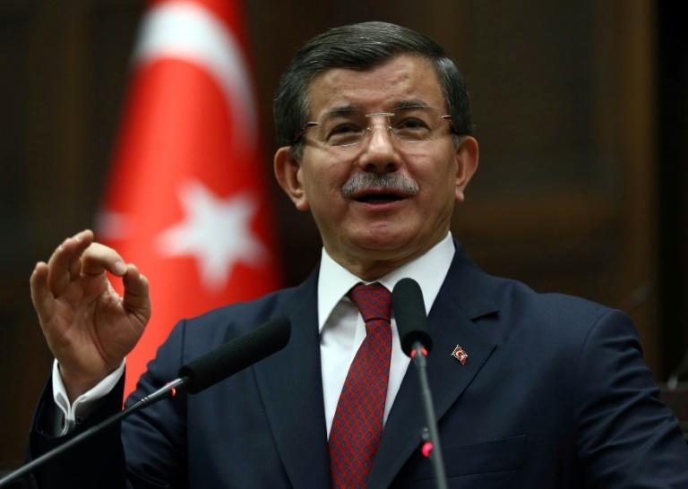 Turkish Prime Minister Ahmet Davutoglu delivers a speech on February 9, 2016 in Ankara