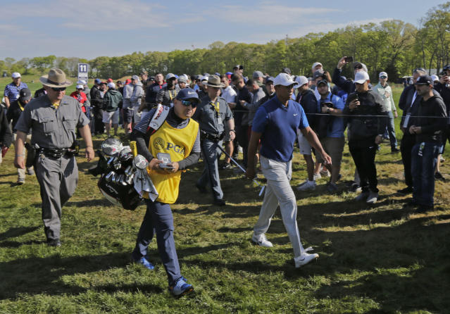 Tiger Woods walks to the 12th tee during the first round of the PGA Championship golf tournament, Thursday, May 16, 2019, at Bethpage Black in Farmingdale, N.Y. (AP Photo/Charles Krupa)