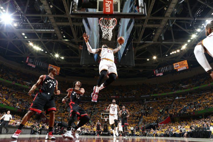 LeBron soars to grab Irving's off-the-backboard pass. (Getty)