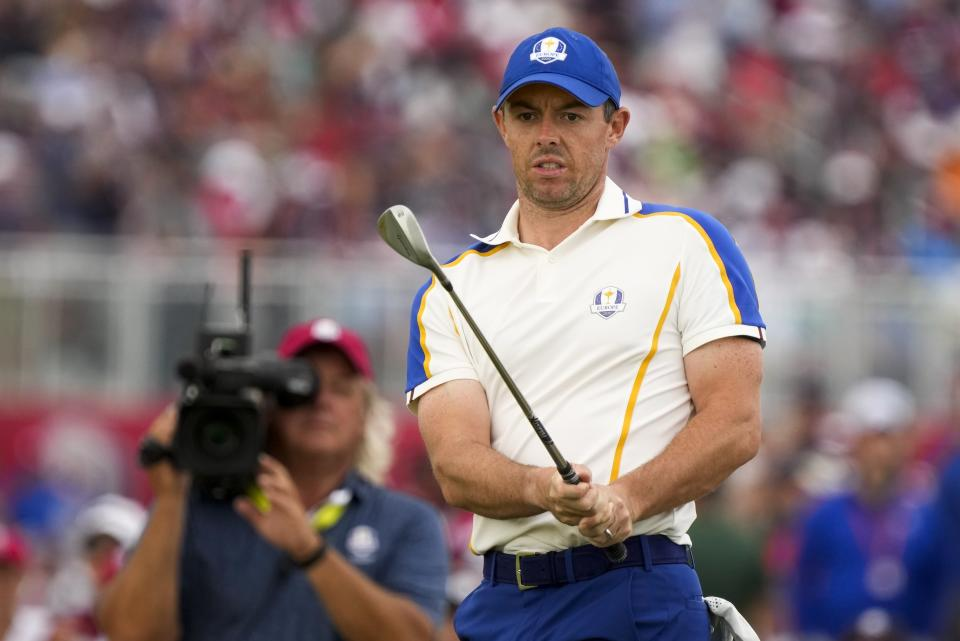 Team Europe's Rory McIlroy watches his shot on the 15th hole during a Ryder Cup singles match at the Whistling Straits Golf Course Sunday, Sept. 26, 2021, in Sheboygan, Wis. (AP Photo/Charlie Neibergall)