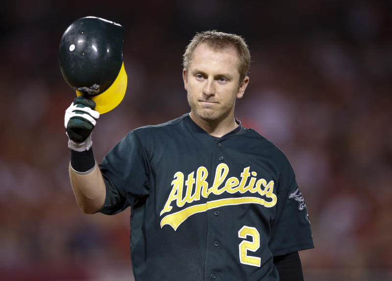 In this Sept. 10, 2012, photo, Oakland Athletics shortstop Cliff Pennington tips his helmet during the Athletics' baseball game against the Los Angeles Angels in Anaheim, Calif. The Athletics traded Pennington to the Arizona Diamondbacks for outfielder Chris Young on Saturday, Oct. 20, 2012. (AP Photo/Jae C. Hong)