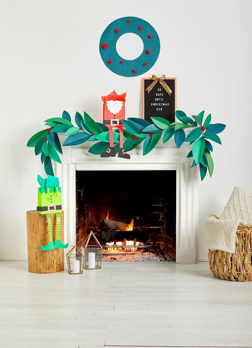 <p>Snag construction paper in two complementary green shades and cut out leaf patterns to make your own Instagram-worthy garland for your mantel.</p>