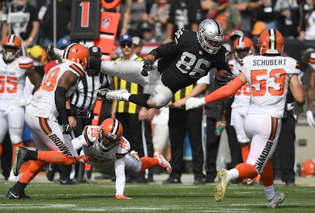 <p>Lee Smith #86 of the Oakland Raiders gets tackled by E.J. Gaines #28 of the Cleveland Browns during the second quarter of their NFL football game at Oakland-Alameda County Coliseum on September 30, 2018 in Oakland, California. (Photo by Thearon W. Henderson/Getty Images) </p>