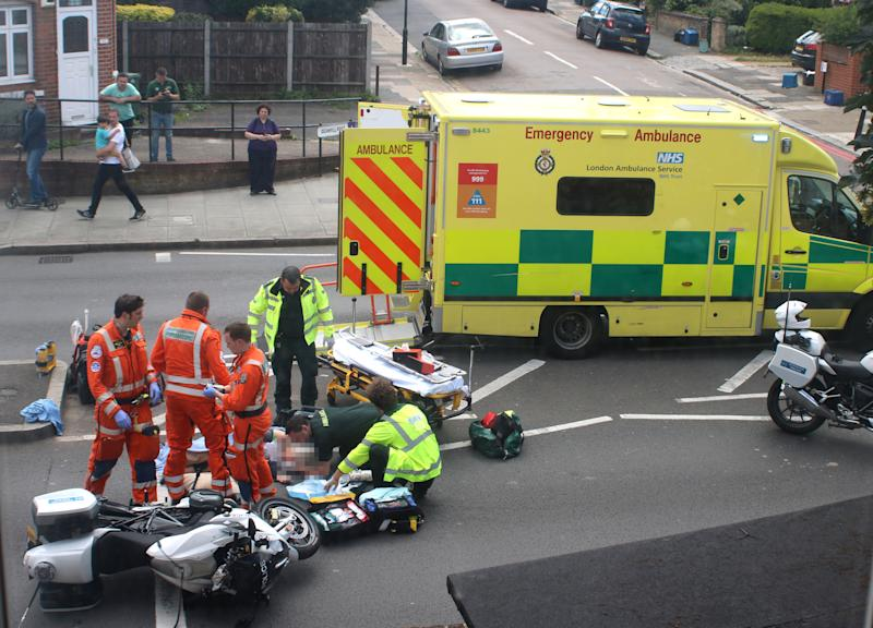 Handout photo dated 17/06/19 of the scene of an accident after a woman was in a collision with a police motorbike escorting the Duke and Duchess of Cambridge. [Photo: PA]