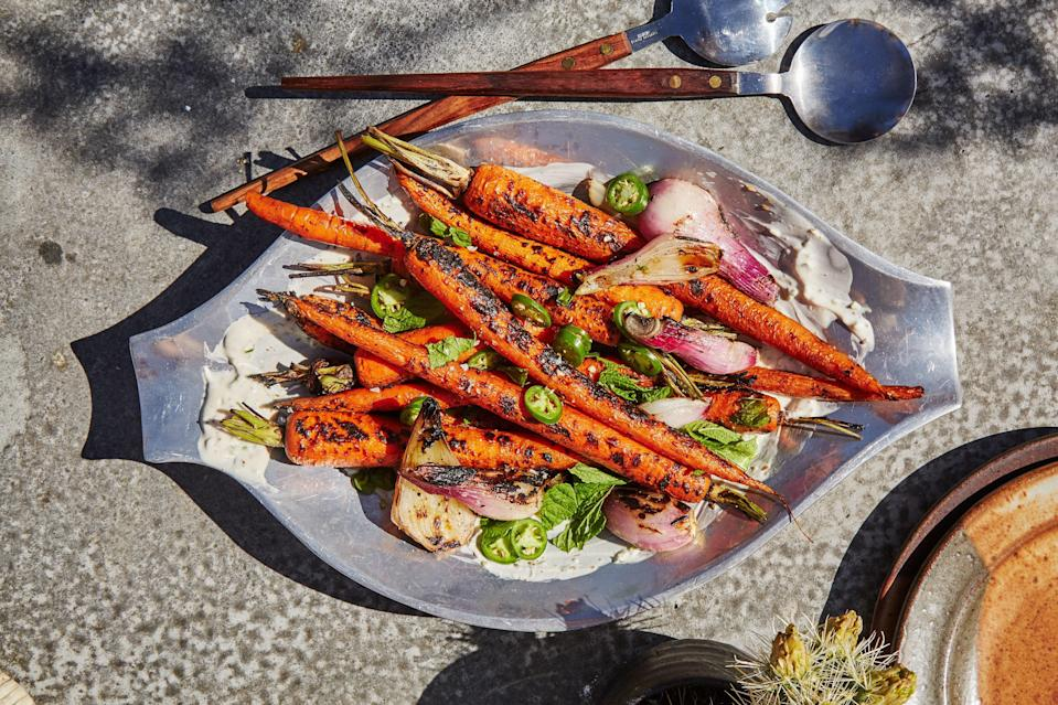 """Carrots love to burn when grilled over direct high heat; better to park them over a cooler spot on the grate and keep the cover closed if possible. <a href=""""https://www.epicurious.com/recipes/food/views/grilled-carrots-with-cumin-serrano-yogurt?mbid=synd_yahoo_rss"""" rel=""""nofollow noopener"""" target=""""_blank"""" data-ylk=""""slk:See recipe."""" class=""""link rapid-noclick-resp"""">See recipe.</a>"""