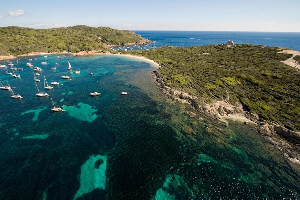 """In the French Riviera, Île de Porquerolles remains a <a href=""""https://www.cntraveler.com/stories/2015-03-24/ile-de-porquerolles-france-french-riviera-cote-d-azur?mbid=synd_yahoo_rss"""" rel=""""nofollow noopener"""" target=""""_blank"""" data-ylk=""""slk:quiet paradise"""" class=""""link rapid-noclick-resp"""">quiet paradise</a> untouched by time and tourism. The entire island is car-free—all you'll find are flawless, empty beaches, thick forests, and a tiny, charming town. We can't think of a better place to tote a picnic basket and spend the day on the sand."""