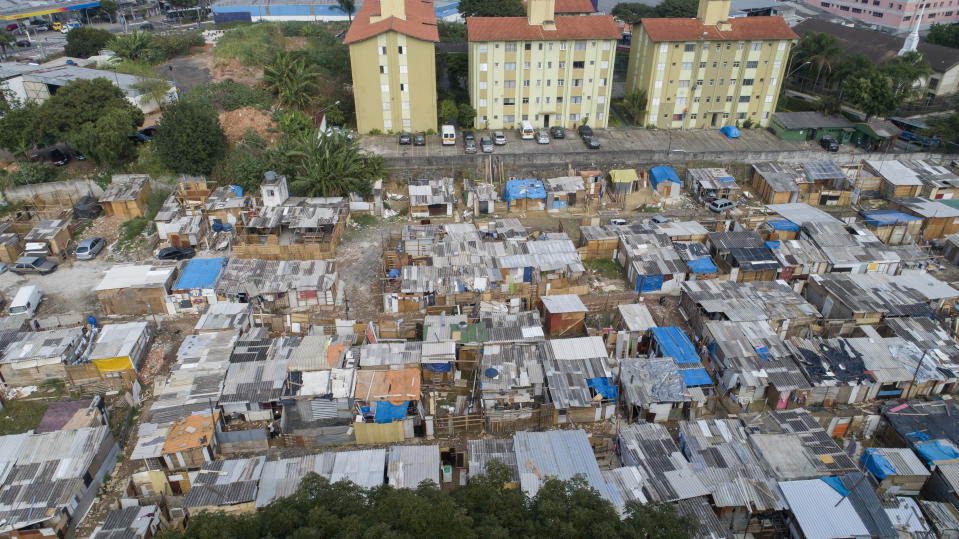 Aerial view of the Penha Brasil Favela where families have started relocating during the coronavirus pandemic in Sao Paulo, Brazil, Saturday, May 15, 2021. Over 200 families live in the Penha Brasil community, one of the new favelas that are sprouting up around Brazil's largest city, inhabited most by newly unemployed workers who lost their jobs and homes as a result of the pandemic. (AP Photo/Andre Penner)