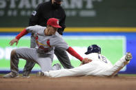 Milwaukee Brewers' Tyrone Taylor (15) is tagged out by St. Louis Cardinals' Tommy Edman (19) on an attempted steal of second during the eighth inning of a baseball game Tuesday, May 11, 2021, in Milwaukee. (AP Photo/Aaron Gash)