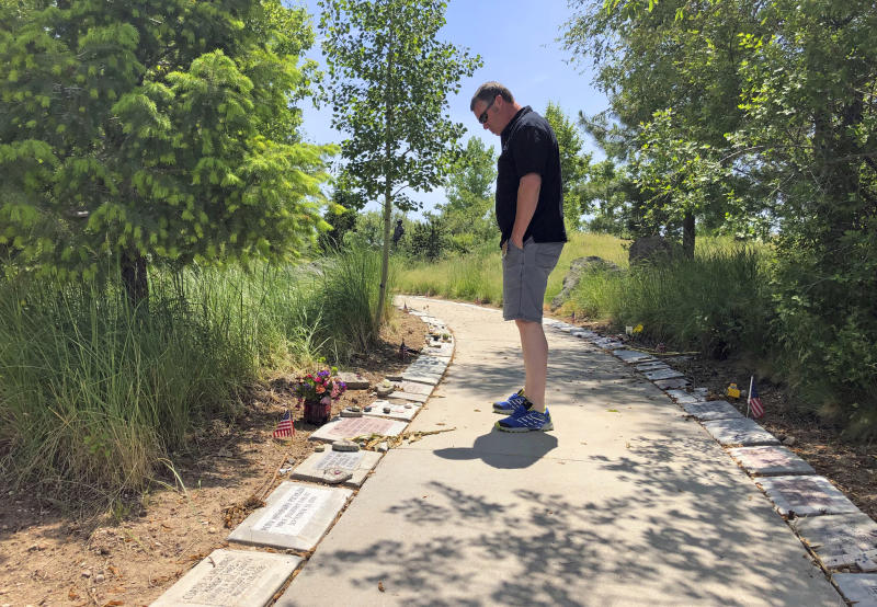 In his June 3, 2019 photo, Bill Arsenault of the Idaho Falls Fire Department looks at memorial stones at the Wildland Firefighters Monument at the National Interagency Fire Center in Boise, Idaho. Federal officials at the NIFC are bolstering mental health resources for wildland firefighters following an apparent increase in suicides. (AP Photo/Keith Ridler)