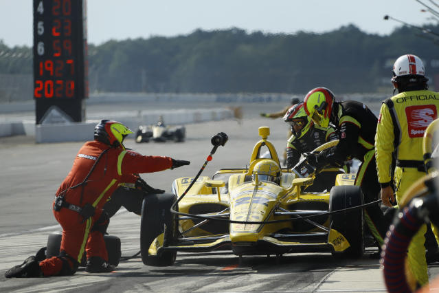 Simon Pagenaud pits during an IndyCar Series auto race at Pocono Raceway, Sunday, Aug. 18, 2019, in Long Pond, Pa. (AP Photo/Matt Slocum)