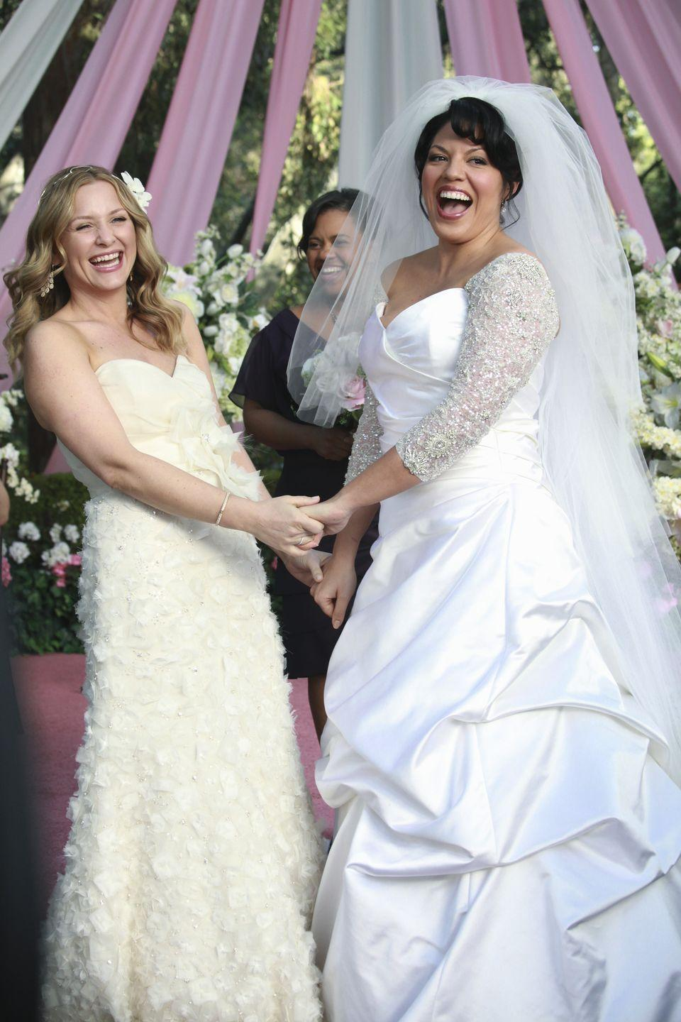<p>There were a lot of obstacles in the way of Callie and Arizona's wedding, from Callie's parents disapproving to their nearly fatal accident, but both brides looked stunning in their own unique wedding dresses. Arizona wore an off-white gown with a sweetheart neck and appliquéd skirt while Callie wore a satin princess gown with embellished sleeves. </p>