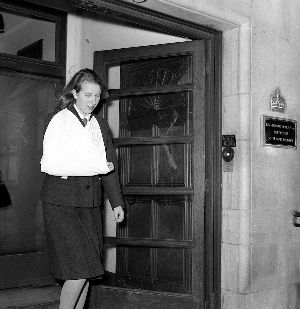 "<p>Leaving the Beaumont Housing Nursing Home after sustaining an injury from a <a href=""https://www.nytimes.com/1964/12/09/archives/princess-anne-injures-hand-in-a-horseriding-accident.html"" rel=""nofollow noopener"" target=""_blank"" data-ylk=""slk:horse riding accident"" class=""link rapid-noclick-resp"">horse riding accident</a>.</p>"