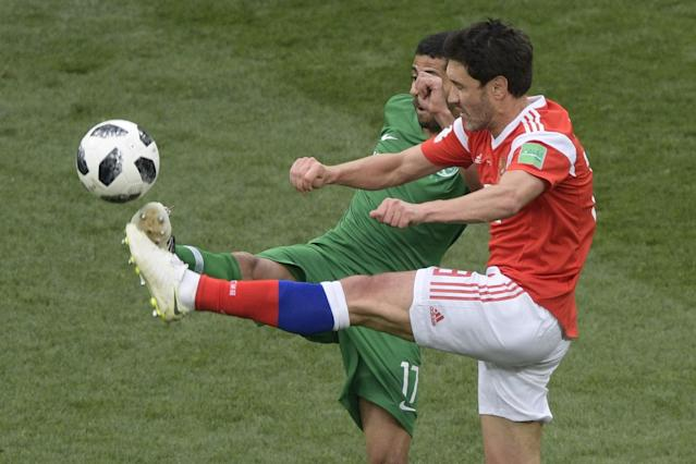 <p>Saudi Arabia's midfielder Taisir Al-Jassim (L) and Russia's midfielder Yury Zhirkov compete for the ball during the Russia 2018 World Cup Group A football match between Russia and Saudi Arabia at the Luzhniki Stadium in Moscow on June 14, 2018. (Photo by Juan Mabromata / AFP) / RESTRICTED TO EDITORIAL USE – NO MOBILE PUSH ALERTS/DOWNLOADS (Getty Images) </p>