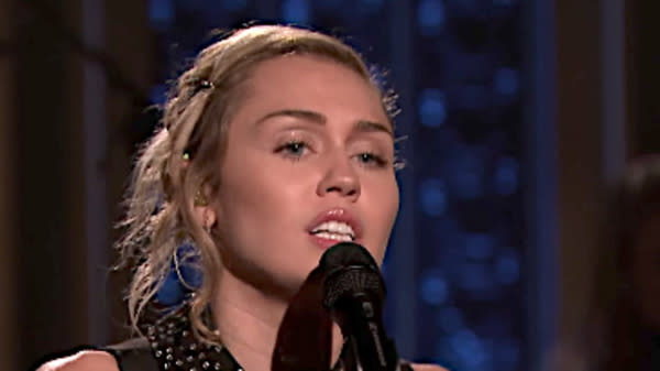 "Miley Cyrus' residency on ""The Tonight Show with Jimmy Fallon"" got off to a somber start on Monday."