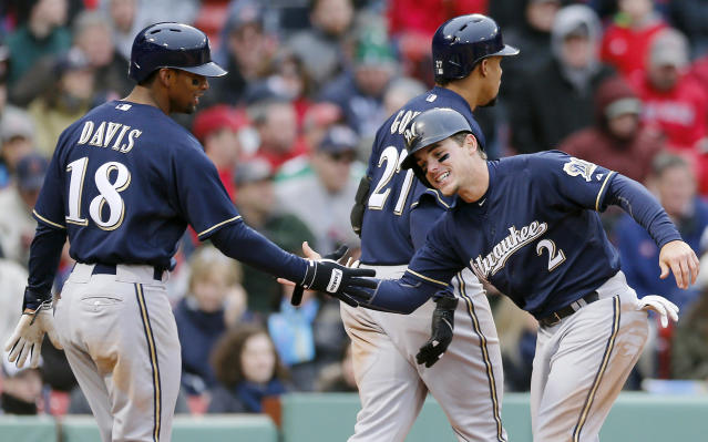 Milwaukee Brewers' Scooter Gennett (2) celebrates with teammate Khris Davis (18) after they scored on a double by Lyle Overbay in the ninth inning of a baseball game against the Boston Red Sox in Boston, Friday, April 4, 2014. The Brewers won 6-2. (AP Photo/Michael Dwyer)