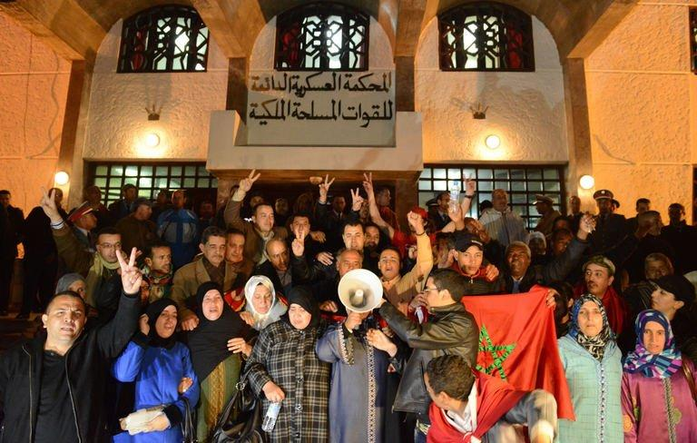 Families of the Moroccan security forces killed in 2010 by a group of Sahrawis, gather outside the court in Rabat on February 17, 2013. The Western Sahara issue is a highly sensitive subject in Morocco, which annexed the former Spanish colony in 1975 in a move not recognised by the international community. The the Sahrawi people in the area have demanded a referendum on self-determination