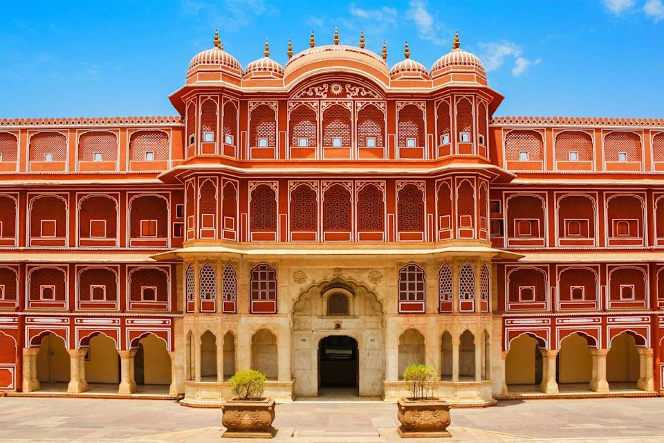 <p>Seas of terracotta and blush shades cover this bustling city, earning Rajasthan's capital the nickname Pink City. Much of the city's rosy hue comes from the natural sandstone used to build many of its renowned landmarks such as the jaw-dropping, honeycomb palace, Hawa Mahal. </p><p>Many of the other buildings in the city were painted to match the orangey-pink hue in 1876 for a visit from Prince Albert and Queen Victoria. At the heart of Jaipur, the City Palace explodes in a kaleidoscope of colors with a vibrant blue ballroom and Peacock Gate.</p>