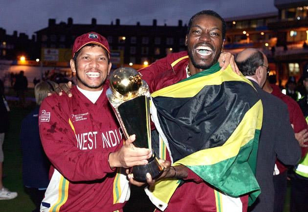 LONDON - SEPTEMBER 25:  Ramnaresh Sarwan and Chris Gayle of West Indies celebrate winning the Final of the ICC Champions Trophy between England and West Indies, on September 25, 2004 at the Oval in London.  (Photo by Mike Hewitt/Getty Images) *** Local Caption *** Ramnaresh Sarwan;Chris Gayle