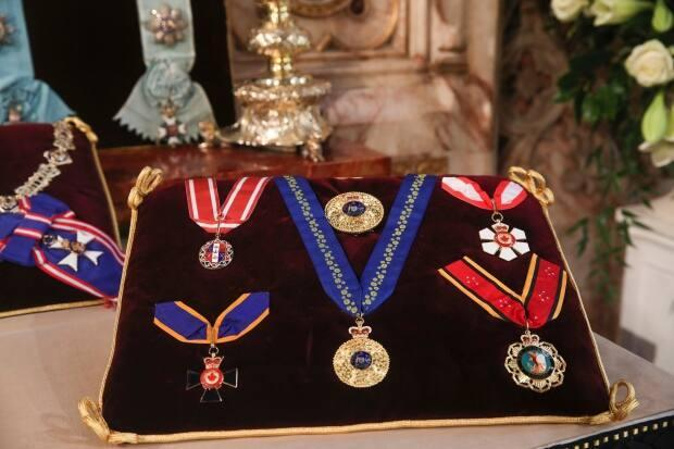 The Canada Order of Military Merit — bottom left — is seen among the late Prince Philip's other insignias in St George's Chapel, Windsor, England, on April 16, 2021. (AP - image credit)