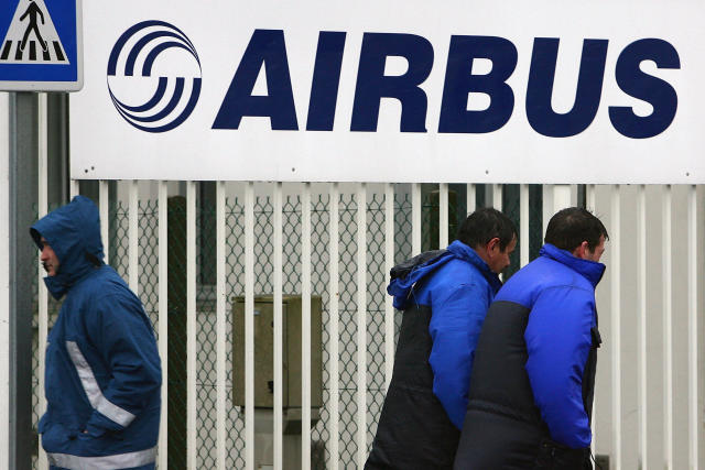 Airbus employees at the entrance of the company's Saint-Nazaire plant in France. (AP Photo/David Vincent)