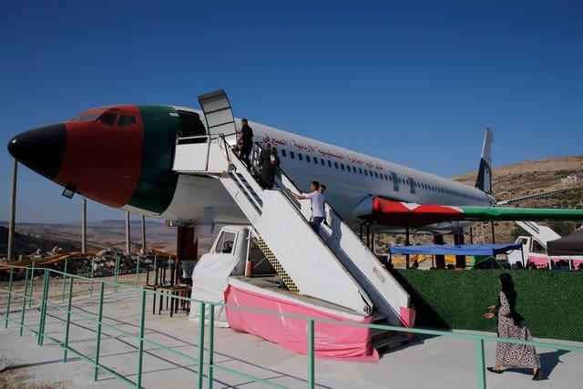 Palestinians visit a Boeing 707 aircraft after it was converted to a restaurant in Wadi Al-Badhan near the West Bank city of Nablus