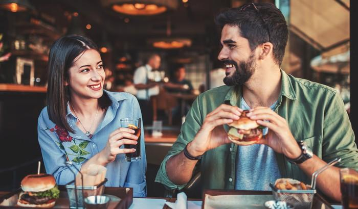 Young couple eating lunch in a fast-casual restaurant.