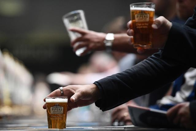 <p>Visitors drink pints of ale and wait to be served at the CAMRA (Campaign for Real Ale) Great British Beer festival at Olympia exhibition center on August 8, 2017 in London, England. (Photo: Carl Court/Getty Images) </p>