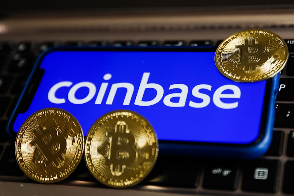 Coinbase logo displayed on a phone screen and representation of Bitcoin are seen in this illustration photo taken in Krakow, Poland on April 15, 2021 (Photo by Jakub Porzycki/NurPhoto via Getty Images)