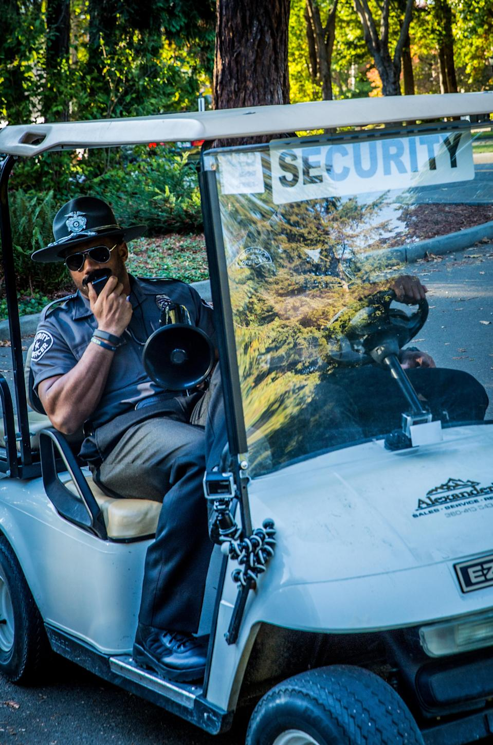 <p>Who's that guy? The Seattle Seahawks quarterback wore a (pretty unconvincing) campus security guard disguise to promote Braun razors at the University of Washington. Besides sporting a 'stache, Officer Wilson offered peronal grooming tips and passed out products to help in that department. (Photo: West2East) </p>