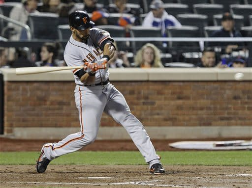 San Francisco Giants' Angel Pagan hits a home run during the third inning of a baseball game against the New York Mets, Friday, April 20, 2012, in New York. (AP Photo/Frank Franklin II)