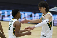 Baylor guard Matthew Mayer, right, celebrates with teammate guard Jared Butler (12) during the first half of a men's Final Four NCAA college basketball tournament semifinal game against Houston, Saturday, April 3, 2021, at Lucas Oil Stadium in Indianapolis. (AP Photo/Darron Cummings)