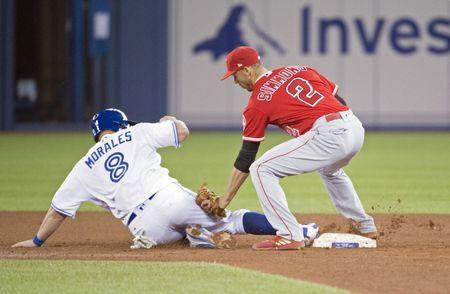 May 22, 2018; Toronto, Ontario, CAN; Toronto Blue Jays designated hitter Kendrys Morales (8) slides safe into second base ahead of the tag from Los Angeles Angels shortstop Andrelton Simmons (2) during the fourth inning at Rogers Centre. Mandatory Credit: Nick Turchiaro-USA TODAY Sports