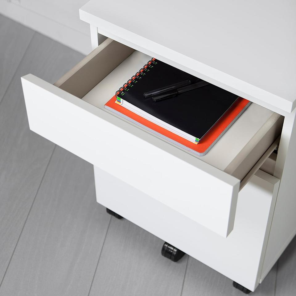 "<p>The <product href=""https://www.ikea.com/us/en/p/malm-drawer-unit-on-casters-white-90340651/"" target=""_blank"" class=""ga-track"" data-ga-category=""Related"" data-ga-label=""https://www.ikea.com/us/en/p/malm-drawer-unit-on-casters-white-90340651/"" data-ga-action=""In-Line Links"">Malm Drawer Unit on Casters</product> ($80) can be rolled to wherever you need it.</p>"