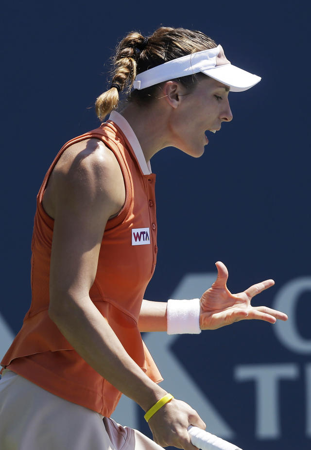 Andrea Petkovic, from Germany, reacts after losing a point to Serena Williams, of the United States, during the first set of their semifinal in the Bank of the West Classic tennis tournament in Stanford, Calif., Saturday, Aug. 2, 2014. (AP Photo/Jeff Chiu)