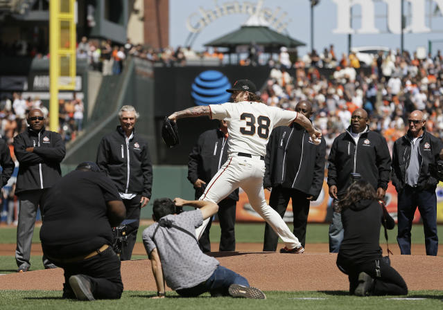 Former Giants closer Brian Wilson thew out the first pitch for the team's home opener on Tuesday without his trademark beard. (AP)