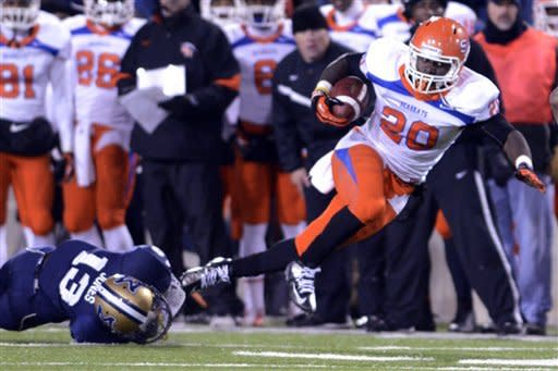 Sam Houston State running back Timothy Flanders (20) runs the ball against Montana State cornerback Darius Jones during the first half of their NCAA college football quarterfinal playoff game in Bozeman, Mont., Friday, Dec. 7, 2012. (AP Photo/Bozeman Daily Chronicle, Adrian Sanchez-Gonzalez)