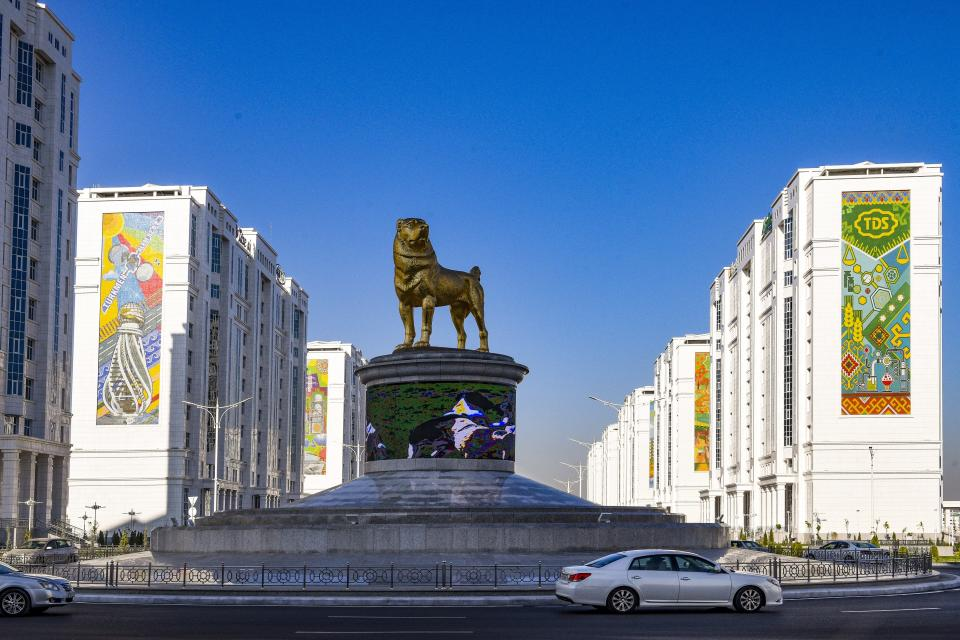 The statue of the Alabai, the Central Asian shepherd dog is seen in Ashgabat, Turkmenistan, Saturday, Nov. 14, 2020. Turkmenistan's autocratic leader has established a national holiday to honor the local dog breed, media reports said Tuesday. President Gurbanguly Berdymukhamedov ordered the holiday praising the Alabai, the Central Asian shepherd dog, to be celebrated on the last Sunday of April when the ex-Soviet nation also marks the day of the local horse breed, according to the daily Neutral Turkmenistan. (AP Photo/Alexander Vershinin)