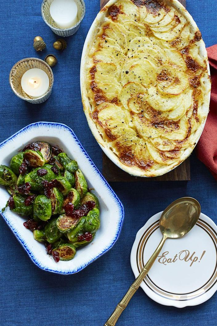 """<p>Cheesy, creamy gratin beats mashed potatoes by leaps and bounds.</p><p><strong><em><a href=""""https://www.womansday.com/food-recipes/food-drinks/recipes/a56466/five-ingredient-potato-gratin-recipe/"""" rel=""""nofollow noopener"""" target=""""_blank"""" data-ylk=""""slk:Get the Five-Ingredient Potato Gratin recipe"""" class=""""link rapid-noclick-resp"""">Get the Five-Ingredient Potato Gratin recipe</a>.</em></strong></p>"""