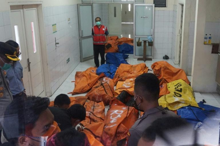 Body bags containing the remains of those killed in a prison fire near Jakarta arrive at the national police hospital in Jakarta (AFP/FAJRIN RAHARJO)