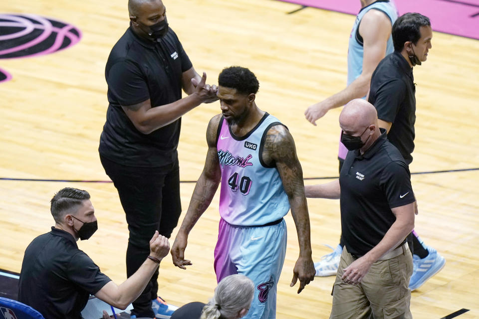 Miami Heat forward Udonis Haslem (40) is escorted off the court after being charged with a technical foul during the first half of the team's NBA basketball game against the Philadelphia 76ers, Thursday, May 13, 2021, in Miami. (AP Photo/Lynne Sladky)