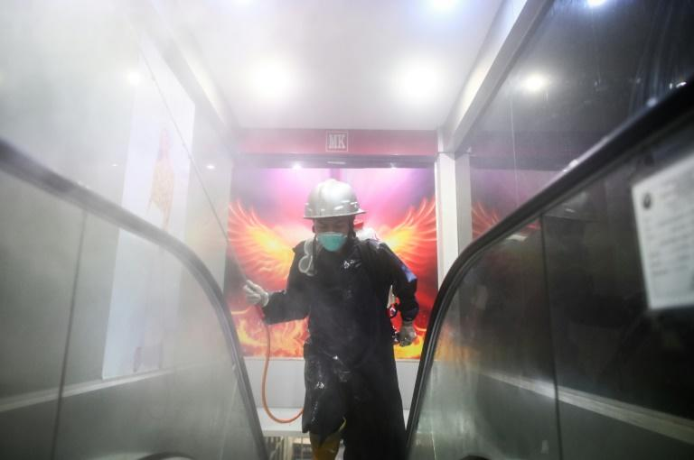 The global coronavirus infection count is fast approaching one million (AFP Photo/Ye Aung Thu)