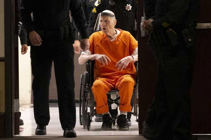 Sacramento County Sheriff's Deputies use a wheelchair to bring Joseph James DeAngelo into the courtroom in Sacramento Superior Court in Sacramento