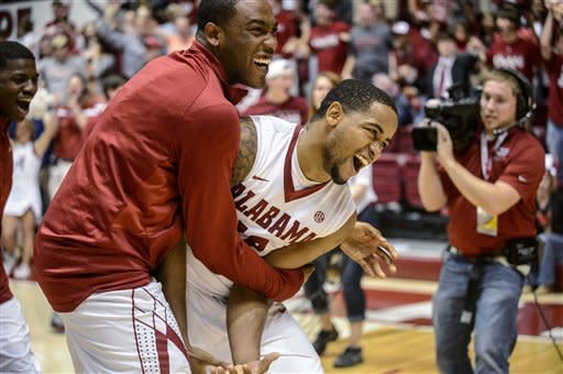 Alabama guard Andrew Steele, left, hugs guard Trevor Releford after Releford hit the game-winning buzzer-beater from 50 feet against Georgia in an NCAA college basketball game Saturday, March 9, 2013, in Tuscaloosa, Ala. Alabama won 61-58. (AP Photo/AL.com, Vasha Hunt)
