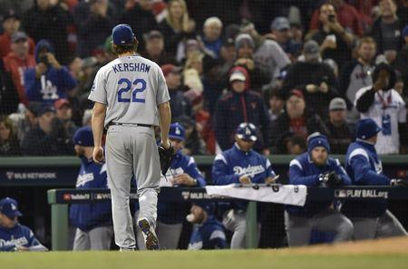 Oct 23, 2018; Boston, MA, USA; Los Angeles Dodgers pitcher Clayton Kershaw (22) walks to the dugout after being relieved against the Boston Red Sox in the fifth inning in game one of the 2018 World Series at Fenway Park. Mandatory Credit: Bob DeChiara-USA TODAY Sports