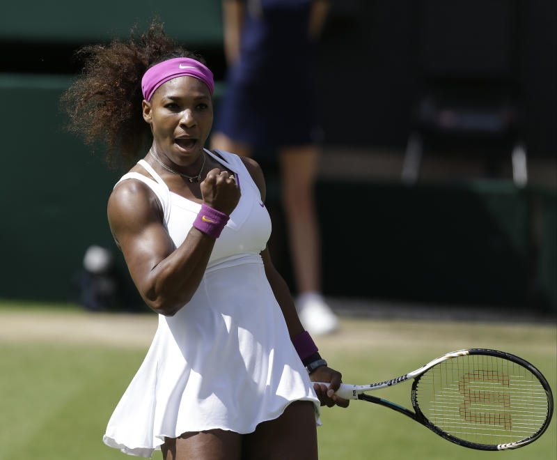Serena Williams of the United States reacts during a semifinals match against  Victoria Azarenka of Belarus at the All England Lawn Tennis Championships at Wimbledon, England, Thursday, July 5, 2012. (AP Photo/Alastair Grant)