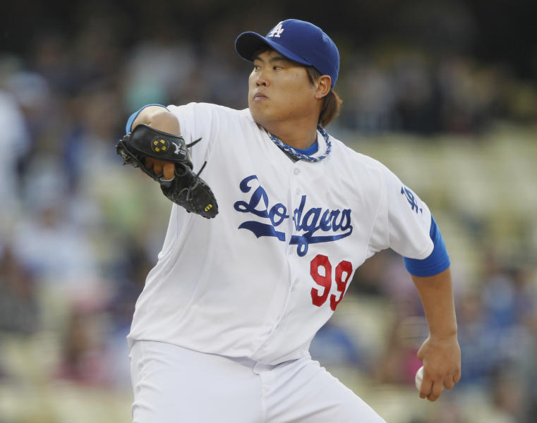 Los Angeles Dodgers starting pitcher Hyun-Jin Ryu starts his delivery against the Atlanta Braves in the first inning of a baseball game Friday, June 7, 2013, in Los Angeles. (AP Photo/Alex Gallardo)