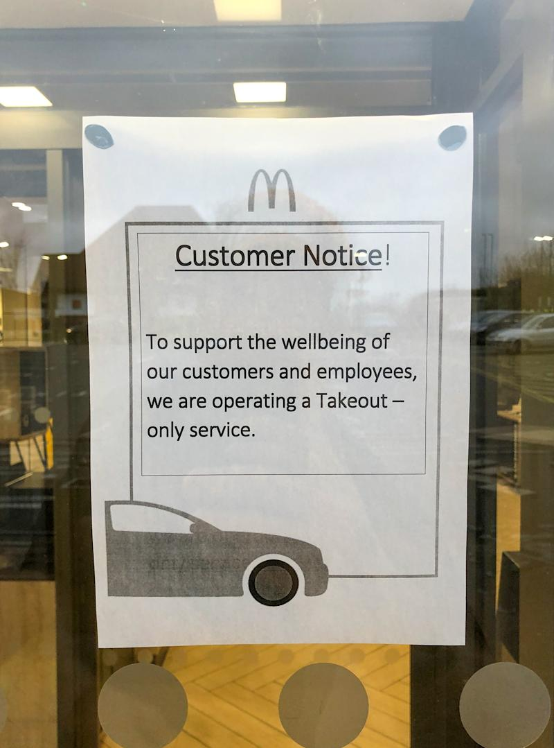A customer notice on the door of a McDonald's restaurant in Leicester, as all McDonalds restaurants in the UK and Ireland become takeaways, drive-thrus and delivery operations as the company attempts to cope with the coronavirus outbreak.