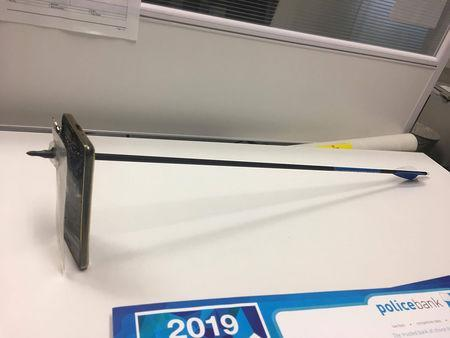 A supplied image obtained March 13, 2019 of a mobile phone pierced by an arrow. AAP Image/Supplied by NSW Police Force/via REUTERS